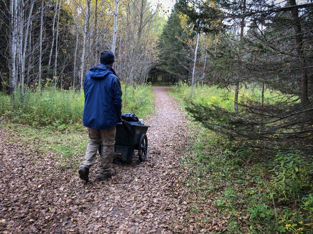 man walking with cart