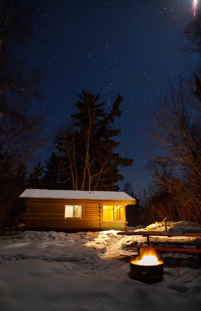 cabin at night under stars
